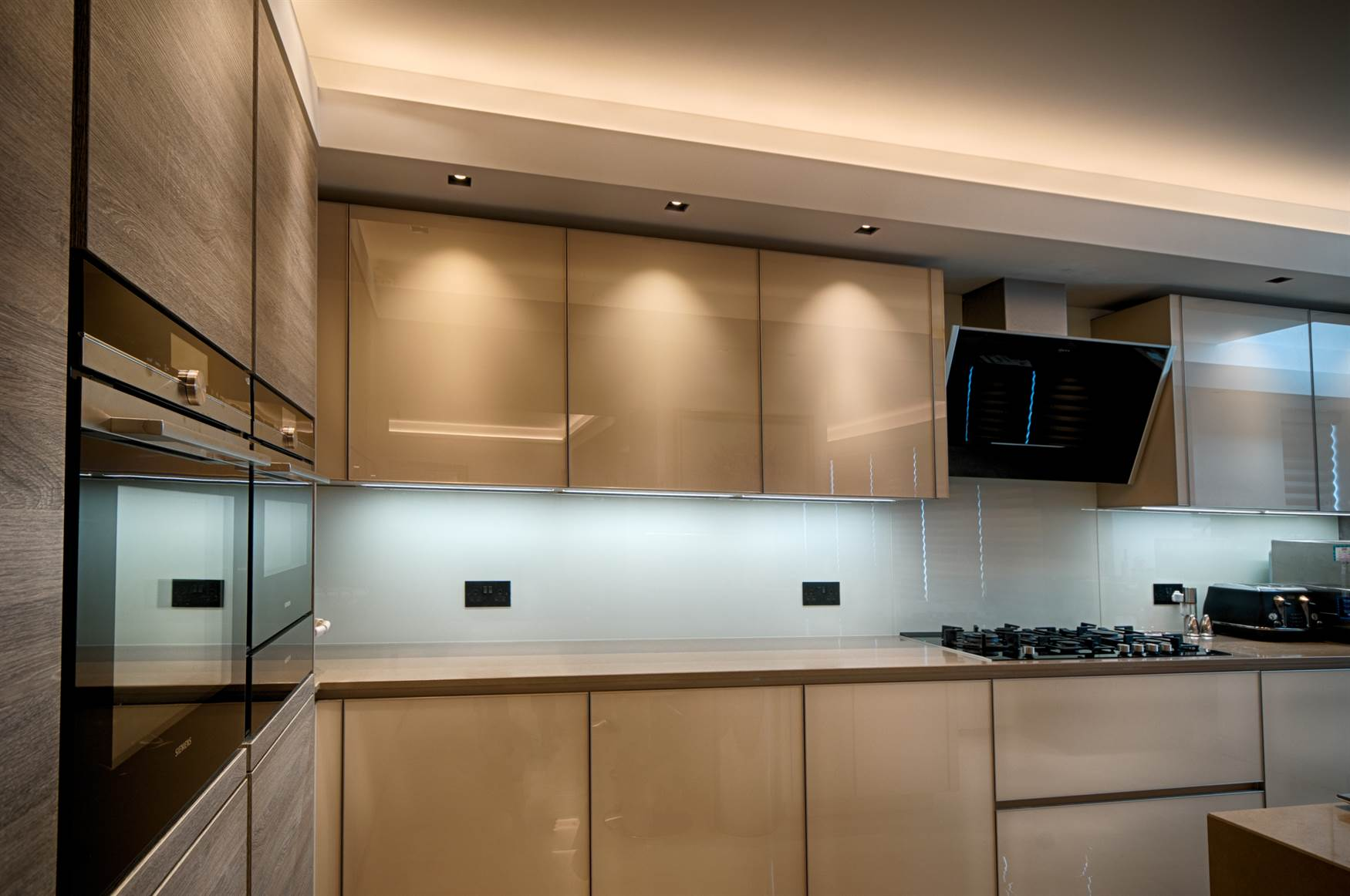 Kitchen cabinets illuminated by trimless downlights