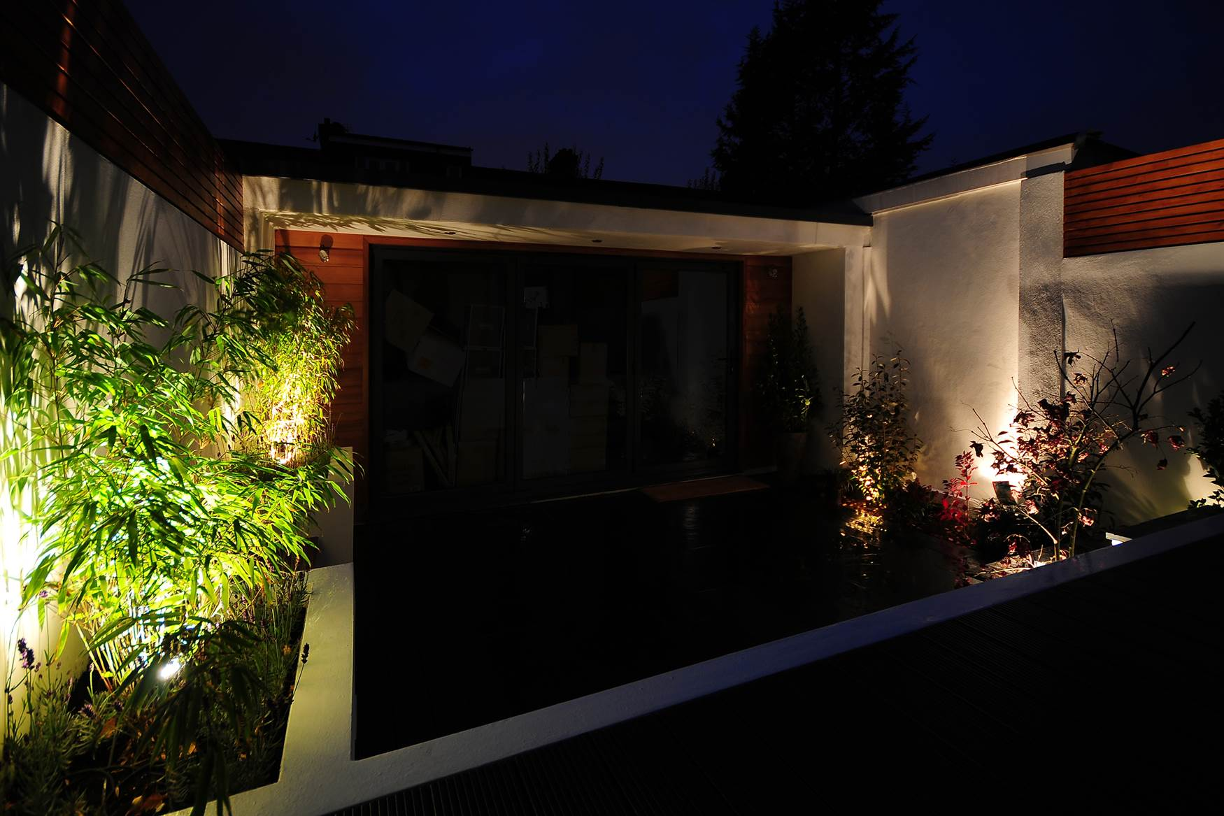 LED tape in flower beds and spotlights
