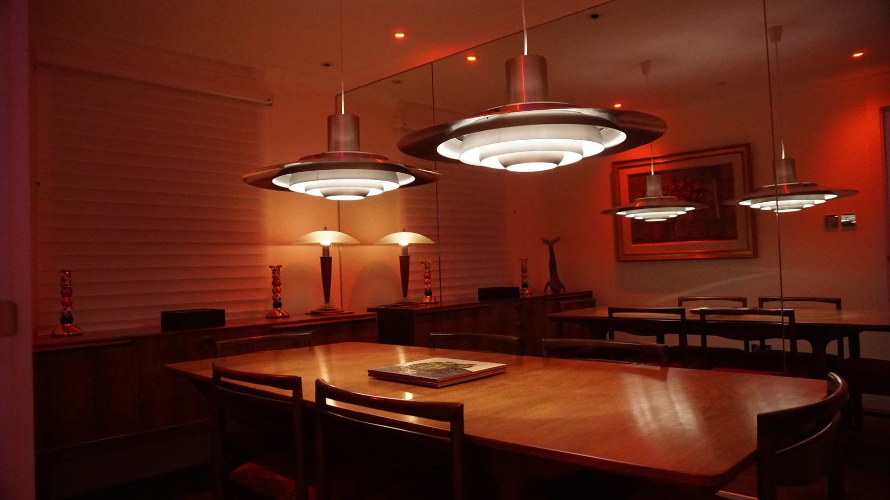 Retro pendants with RGBW downlights in dining room